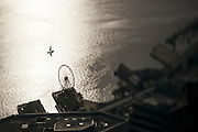 A sailboat and Seattle's Great Wheel seem tiny when seen from the Columbia Center's Sky View Observatory. Image taken with a tilt-shift lens. (Bettina Hansen / The Seattle Times)