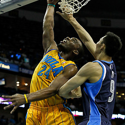 January 21, 2012; New Orleans, LA, USA; New Orleans Hornets power forward Carl Landry (24) dunks over Dallas Mavericks power forward Yi Jianlian (9) during the first quarter of a game at the New Orleans Arena.   Mandatory Credit: Derick E. Hingle-US PRESSWIRE