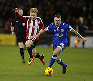 Mark Duffy of Sheffield Utd tussles with Peter Clarke of Oldham during the English League One match at Bramall Lane Stadium, Sheffield. Picture date: December 26th, 2016. Pic Simon Bellis/Sportimage