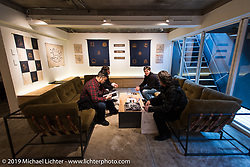 Harley-Davidson's (L>R) Dais Nagao, Ben McGinley, Charlie Wartgow and head of design Ray Drea at the Deus Ex Machina new Tokyo store 3-days after its grand opening. Tokyo. Japan. Wednesday, December 10, 2014. Photograph ©2014 Michael Lichter.