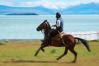 Gaucho riding a horse at Estancia Helsingfors in Patagonia. Image taken with a Nikon D3s camera and 24-120 mm f/4  lens (ISO 200, 120 mm, f/22, 1/50 sec)