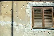 Wall showing bullet damage from 1991 -- 1995 war. Petrinja, Croatia