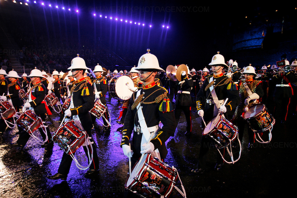 Performers and musicians put on a colourful display at the opening night of the Edinburgh Tattoo 31st July 2008 - Edinburgh, Scotland, Britain.  The event is regarded as the largest outdoor military tattoo in the world and is staged against the imposing backdrop of Edinburgh Castle.   Pictured the Bands of Her Majesty's Royal Marines.