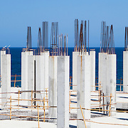 Reinforced support columns at a building construction site near the sea.<br /> <br /> LICENSING: This image can only be licensed through SpacesImages. Click on the link below:<br /> <br /> http://tinyurl.com/cjmo8za