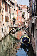 Women cross a canal bridge in Venice. Venezia, founded in the 400s AD, is capital of Italy's Veneto region, named for the ancient Veneti people from the 900s BC. The romantic City of Canals stretches across 100+ small islands in the marshy Venetian Lagoon along the Adriatic Sea, between the mouths of the Po and Piave Rivers. The Republic of Venice was a major maritime power during the Middle Ages and Renaissance, a staging area for the Crusades, and a major center of art and commerce (silk, grain and spice trade) from the 1200s to 1600s. The wealthy legacy of Venice stands today in a rich architecture combining Gothic, Byzantine, and Arab styles. Venice and the Venetian Lagoon are honored on UNESCO's World Heritage List.