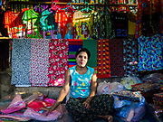21 NOVEMBER 2017 - PANTANAW, AYEYARWADY REGION, MYANMAR: A clothing vender in the market in Pantanaw, a town near Pathien in the Ayeyarwady delta.    PHOTO BY JACK KURTZ