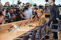 18 JUL 2014, BERLIN/GERMANY:<br /> Angela Merkel, CDU, Bundeskanzlerin, vor Beginn der sog. Sommer-Pressekonferenz der Bundeskanzlerin zu aktuellen Themen der Innen- und Außenpolitik, Bundespressekonferenz<br /> IMAGE: 20140718-01-005<br /> KEYWORDS: Kamera, Camera, Journalist, Journalisten, Fotografen, Kameraleute