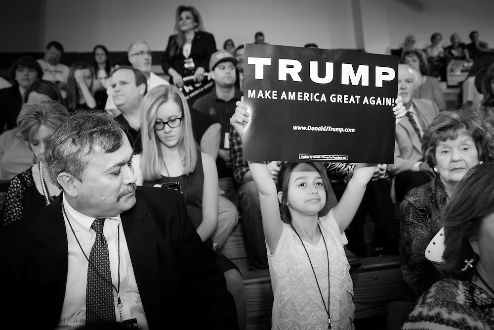 Madison, Mississippi, March 7, 2016 A young girl holds up a Trump sign at a Trump rally  the day before Mississippi primary.