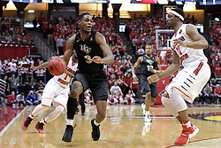 20 March 2017:  A.J. Davis into the corner with MiKyle McIntosh(11) during a College NIT (National Invitational Tournament) 2nd round mens basketball game between the UCF (University of Central Florida) Knights and Illinois State Redbirds in  Redbird Arena, Normal IL