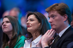 © Licensed to London News Pictures . 08/10/2014 . Glasgow , UK . Jo Swinson , Miriam Gonzalez Durantez ( Nick Clegg's wife) and Danny Alexander listen as Nick Clegg , Deputy Prime Minister and Party Leader , delivers his keynote speech at the close of the conference . The Liberal Democrat Party Conference 2014 at the Scottish Exhibition and Conference Centre in Glasgow . Photo credit : Joel Goodman/LNP