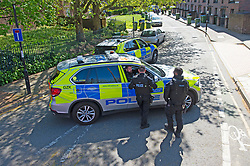 ©Licensed to London News Pictures 20/04/2020  <br /> Charlton, UK.  Metropolitan police officers surrounded a property near Charlton football club, Charlton, South East London today to arrested a suspect. The man who is believed to have been running from police was trapped in a back garden by at least ten armed police officers and a police dog.<br />  Reports on social media show footage of a white van in a high speed pursuit, it is not confirmed to be linked to this incident at the present time. Photo credit:Grant Falvey/LNP