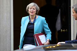 © Licensed to London News Pictures. 26/10/2016. London, UK. Prime Minister THERESA MAY leaves Downing Street in London to attend Prime Minister's Question Time on Wednesday, 26 October 2016. Photo credit: Tolga Akmen/LNP