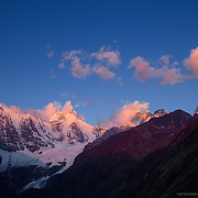 West facing peaks during sunset near Lake Jahuacocha in the Cordillera Huayhuash in the Andes Mountains of Peru.
