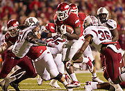 Nov 5, 2011; Fayetteville, AR, USA;  Arkansas Razorback runningback Broderick Green (29) carries the ball as South Carolina Gamecocks strong safety D.J. Swearinger (36) and cornerback Stephon Gilmore (5) make the tackle during a game at Donald W. Reynolds Stadium.  Mandatory Credit: Beth Hall-US PRESSWIRE