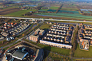Nederland, Noord-Brabant, Veghel,  10-01-2011;.Nieuwbouwwijk in Veghel, rijksweg A50 bovenin beeld. New housing estate in the village of Veghel..luchtfoto (toeslag), aerial photo (additional fee required).foto/photo Siebe Swart