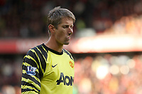 Football - Premier League - Manchester United vs. West Bromich Albion<br /> Edwin van der Sar of Manchester United leaves the field deep in thought following the final whistle at Old Trafford