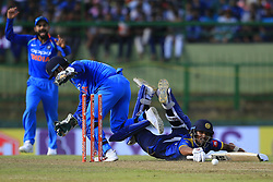 August 27, 2017 - Kandy, Sri Lanka - Sri Lankan cricketer Dinesh Chandimal (R) dives in to survive a runout as India's wicket keeper MS Dhoni (L) removes the bails during the 3rd One Day International cricket match between Sri Lanka and India at the Pallekele international cricket stadium at Kandy, Sri Lanka on Sunday 27 August 2017. (Credit Image: © Tharaka Basnayaka/NurPhoto via ZUMA Press)