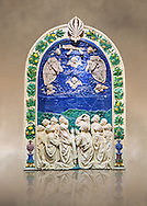 Enamelled terracotta relief panel of the Ascension of Christ made around 1490 for the Cordoni chapel in the church of Saint Agostino in the Citta de Castello, Umbria, Italy by Andrea  della Robbia of Florence.  The Louvre Museum, Paris. .<br /> <br /> If you prefer you can also buy from our ALAMY PHOTO LIBRARY  Collection visit : https://www.alamy.com/portfolio/paul-williams-funkystock/florentine-enamel-antiquities.html <br /> <br /> Visit our MEDIEVAL ART PHOTO COLLECTIONS for more   photos  to download or buy as prints https://funkystock.photoshelter.com/gallery-collection/Medieval-Gothic-Art-Antiquities-Historic-Sites-Pictures-Images-of/C0000gZ8POl_DCqE