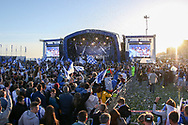 The stage is covered with ticker tape and the fans celebrate during the Brighton & Hove Albion Football Club Promotion Parade at Brighton Seafront, Brighton, United Kingdom on 14 May 2017. Photo by Phil Duncan.