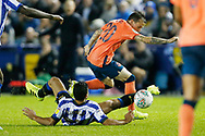 Bernard of Everton and Massimo Luongo of Sheffield Wednesday contest a loose ball  during the EFL Cup match between Sheffield Wednesday and Everton at Hillsborough, Sheffield, England on 24 September 2019.