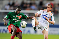 FOOTBALL - FRENCH CHAMPIONSHIP 2010/2011 - L2 - CS SEDAN v STADE LAVALLOIS - 22/04/2011 - PHOTO GUILLAUME RAMON / DPPI - JEROME LEBOUC (LAVAL)  AND ISMAEL TRAORE (SEDAN)