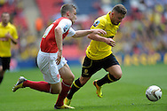 Burton Albion's Alex MacDonald is chased by  Fleetwood Town's Charlie Taylor .Skybet football league two play off final match , Burton Albion v Fleetwood Town at Wembley Stadium in  London on Monday 26th May 2014.<br /> pic by John Patrick Fletcher, Andrew Orchard sports photography.