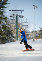 Great conditions greeted skiers and riders on opening day at Gunstock Mountain Resort Friday.  (Karen Bobotas Photo/for The Laconia Daily Sun)