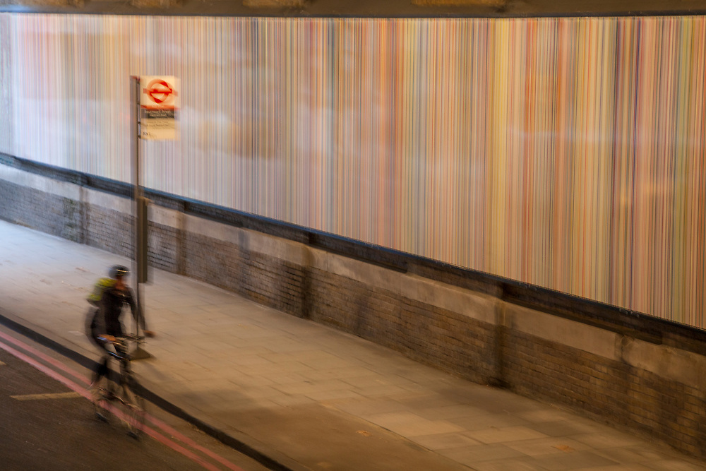 Woman commuting through London underpass tunnel in blur motion.  Licensing and Open Edition Prints.