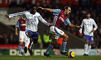 Photo: Paul Thomas.<br /> Aston Villa v Chelsea. The Barclays Premiership. 02/01/2007.<br /> <br /> Michael Essien (L) of Chelsea chases down Gavin McCann.
