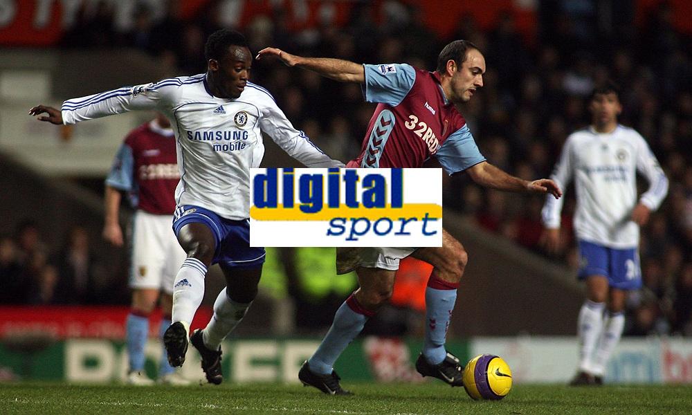 Photo: Paul Thomas.<br /> Aston Villa v Chelsea. The Barclays Premiership. 02/01/2007.<br /> <br /> Michael Essien (L) of Chelsea chases down Gavin McCann.
