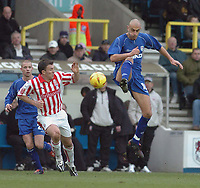 Photo. Leigh Quinnell.  Millwall v Stoke City Coca Cola championship. 19/02/2005. Millwalls Danny Dichio jumps in for a tackle on Stokes David Brammer.