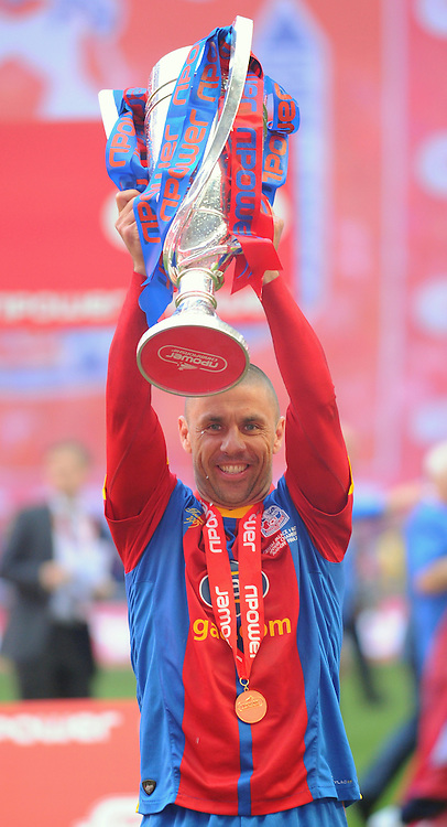 Picture by Seb Daly/Focus Images Ltd +447738 614630.27/05/2013.Kevin Phillips of Crystal Palace celebrates by lifting the trophy after winning the npower Championship play off final at Wembley Stadium, London.