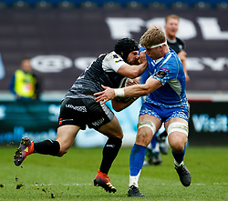 Dan Evans of Ospreys under pressure from Aaron Wainwright of Dragons<br /> <br /> Photographer Simon King/Replay Images<br /> <br /> Guinness PRO14 Round 18 - Ospreys v Dragons - Saturday 23rd March 2019 - Liberty Stadium - Swansea<br /> <br /> World Copyright © Replay Images . All rights reserved. info@replayimages.co.uk - http://replayimages.co.uk