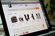 Yuan Keru, a 23 year old graduate student at the China Academy of Arts, shops online on T Mall, as the clock strikes zero hour for the November 11th shopping festival at her apartment that she shares with her boyfriend in Hangzhou , China on 11 November 2013. Alibaba, the parent company of T Mall, recorded $5.78 billion of sales during this Chinese version of Black Friday in 2013, as people in China increasingly log on to their computers to shop.