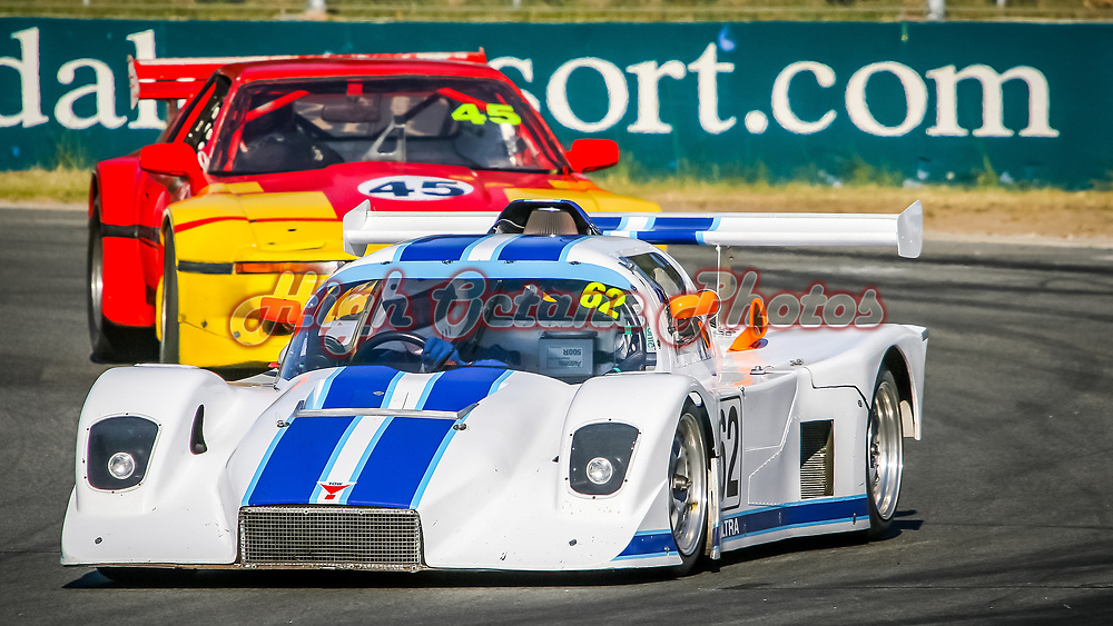 Peter McKenzie (62 - Ultra Sports) leads John Glasson (45 - Toyota Supra) onto the main straight at Wanneroo Raceway.