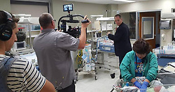 September 6, 2017 - Biloxi, MS, USA - An ABC film crew follows Singing River Hospital's Dr. Tyler Sexton, a real life inspiration for shows like ABC's ''The Good Doctor'' to debut locally on Sept. 25. Sexton makes his rounds at the hospital's newborn nursery, while being filmed for a feature to promote the show. (Credit Image: © Karen Nelson/TNS via ZUMA Wire)