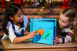 "© Licensed to London News Pictures. 13/11/2019. LONDON, UK. (L to R) Fiona (aged 10) and Gwen (aged 8) play with a Ryan's World Super Surprise Safe by Flair Leisure Products at the preview of ""DreamToys"", the official toys and games Christmas Preview, held at St Mary's Church in Marylebone.  Recognised as the countdown to Christmas, the Toy Retailer's Association, an independent panel of leading UK toy retailers, have selected the definitive and most authoritative list of which toys will be the hottest property this Christmas.  Photo credit: Stephen Chung/LNP"