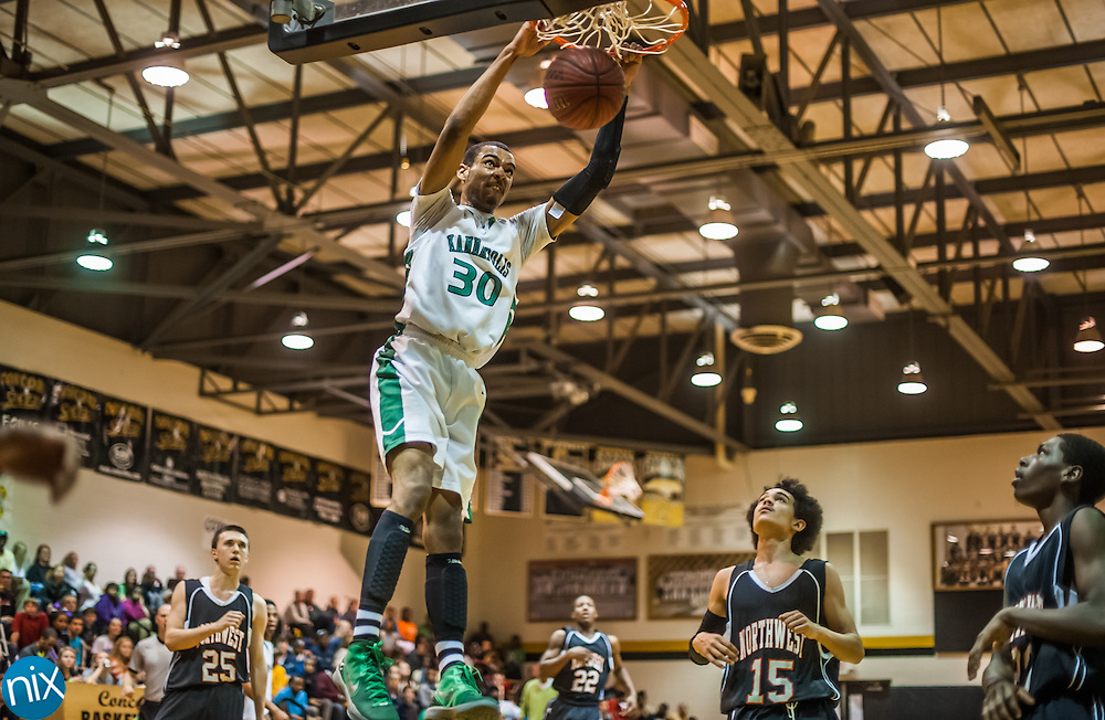 Kannapolis' Tydus Parks dunks the ball against Northwest Cabarrus Tuesday night during the semi-finals of the South Piedmont Conference Tournament at Concord High School. The Wonders defeated Northwest 71-69 to advance to the finals against Cox Mill.