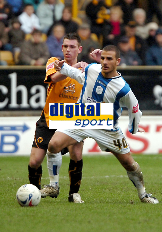 Photo: Ed Godden.<br />Wolverhampton Wanderers v Sheffield Wednesday. Coca Cola Championship. 25/03/2006. <br />Wolves' Mark Davies (L) is challenged by Marcus Tudgay (R).