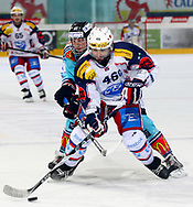 19.03.2011, Rapperswil-Jona, Eishockey NLA Playout, Rapperswil-Jona Lakers - HC Ambri-Piotta, Tanner Richard (LAK) gegen Paolo Duca (AMB)  (Thomas Oswald/hockeypics)