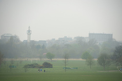 © Licensed to London News Pictures. 03/04/2014. London, UK. A mosque tower is almost completely shrouded.  Views of central London shrouded in fog this morning 3rd April 2014 from Regents Park. Photo credit : Stephen Simpson/LNP