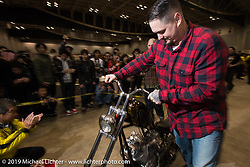Paul Wideman walks his bike into the hall at the Annual Mooneyes Yokohama Hot Rod and Custom Show. Japan. Sunday, December 7, 2014. Photograph ©2014 Michael Lichter.