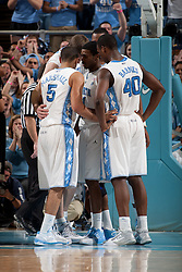 CHAPEL HILL, NC - FEBRUARY 15: Kendall Marshall #5 and Harrison Barnes #40 of the North Carolina Tar Heels huddle while playing against the Wake Forest Demon Deacons at the Dean E. Smith Center in Chapel Hill, North Carolina. North Carolina won 64-78. (Photo by Peyton Williams/UNC/Getty Images) *** Local Caption *** Kendall Marshall;Harrison Barnes