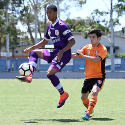BRISBANE, AUSTRALIA - JANUARY 8: Jamal Reiners of the Glory controls the ball in front of Joe Caletti of the Roar during the round 8 Foxtel National Youth League match between the Brisbane Roar and Perth Glory at AJ Kelly Field on January 8, 2017 in Brisbane, Australia. (Photo by Patrick Kearney/Brisbane Roar)