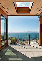 A new ocean-side home constructed by Falcon Heights Contracting features contemporary architecture by Zebra Design and millwork by Thetis Cove Joinery of Victoria, BC.