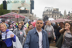 Trafalgar Square, London, June 12th 2016. Rain greets Londoners and visitors to the capital's Trafalgar Square as the Mayor hosts a Patron's Lunch in celebration of The Queen's 90th birthday. PICTURED: Mayor of London Sadiq Khan tours the event.