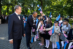 President Barack Obama, with President Toomas Hendrik Ilves of Estonia, greets students during an official arrival ceremony at Kadriorg Palace in Tallinn, Estonia, Sept. 3, 2014. (Official White House Photo by Pete Souza)<br /> <br /> This official White House photograph is being made available only for publication by news organizations and/or for personal use printing by the subject(s) of the photograph. The photograph may not be manipulated in any way and may not be used in commercial or political materials, advertisements, emails, products, promotions that in any way suggests approval or endorsement of the President, the First Family, or the White House.