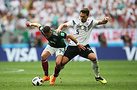MOSCOW, RUSSIA - JUNE 17: Javier Hernandez of Mexico vies with Mats Hummels of Germany during the 2018 FIFA World Cup Russia group F match between Germany and Mexico at Luzhniki Stadium on June 17, 2018 in Moscow, Russia. (Photo by Ian MacNicol/Getty Images)
