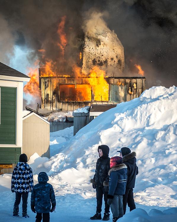 Bunch of kids watching the fire.