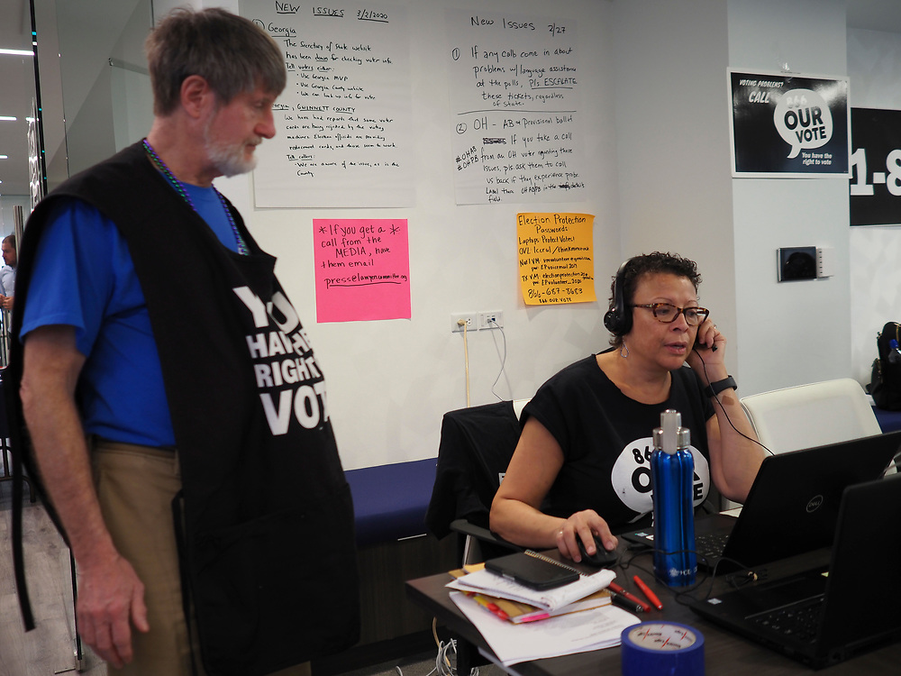 Election Protection volunteers confer on how to best respond to voters' calls.